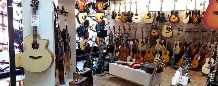 Shopping with a friend who is proficient in guitar