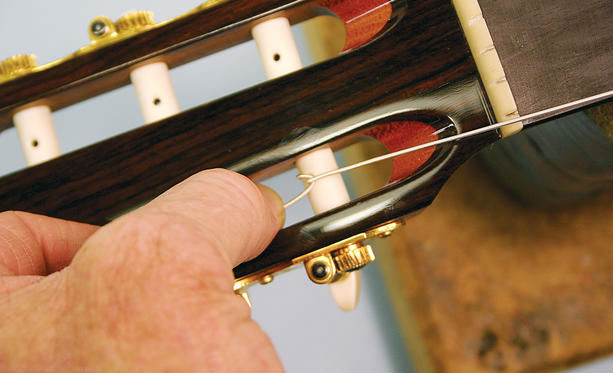 how to tie nylon strings on an acoustic guitar is it strange. Black Bedroom Furniture Sets. Home Design Ideas