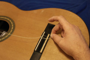 Tie Nylon Strings On An Acoustic Guitar