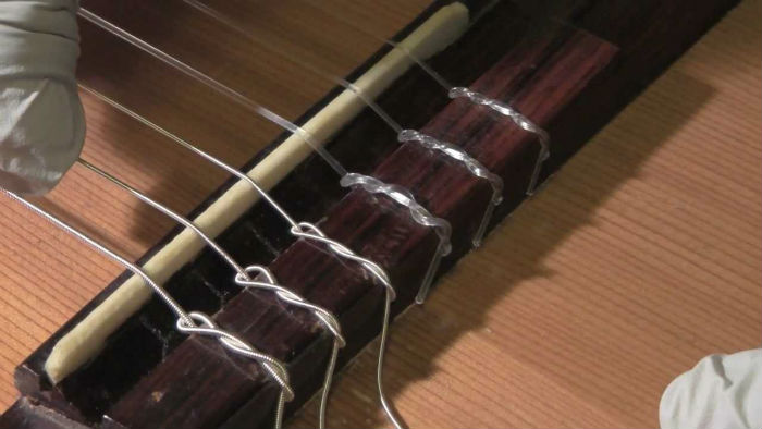 Can you use nylon strings on an acoustic guitar